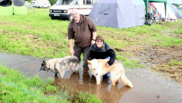 Draco, Paul, and Freya wash off the mud while camping
